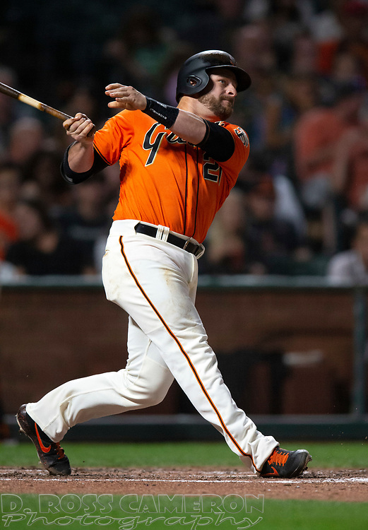 Sep 13, 2019; San Francisco, CA, USA; San Francisco Giants Stephen Vogt (21) follows through on his leadoff double against the Miami Marlins during the inning of a baseball game at Oracle Park. Vogt scored later in the inning. Mandatory Credit: D. Ross Cameron-USA TODAY Sports