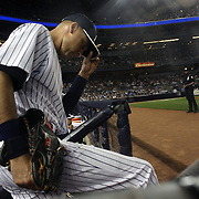 Derek Jeter, New York Yankees, playing in his final season, heads out from the dug out to field at shortstop  during the New York Yankees V New York Mets, Subway Series game at Yankee Stadium, The Bronx, New York. 12th May 2014. Photo Tim Clayton