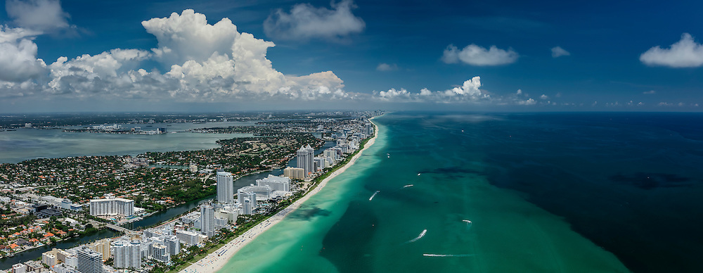 Miami Beach from the air with Biscayne Bay and the Atlantic Ocean.  Looking north