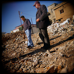 Hassan and Hussein Al-Akhrass visit the site where their family members were killed in the war between Israel and Hezbollah, Aytaroun, Southern Lebanon, Oct. 23, 2006.