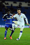 Leeds United's Mirco Antenucci (7) holds off Cardiff City's Bruno Ecuele Manga. Skybet football league championship match, Cardiff city v Leeds Utd at the Cardiff city stadium in Cardiff, South Wales on Tuesday 8th March 2016.<br /> pic by Carl Robertson, Andrew Orchard sports photography.