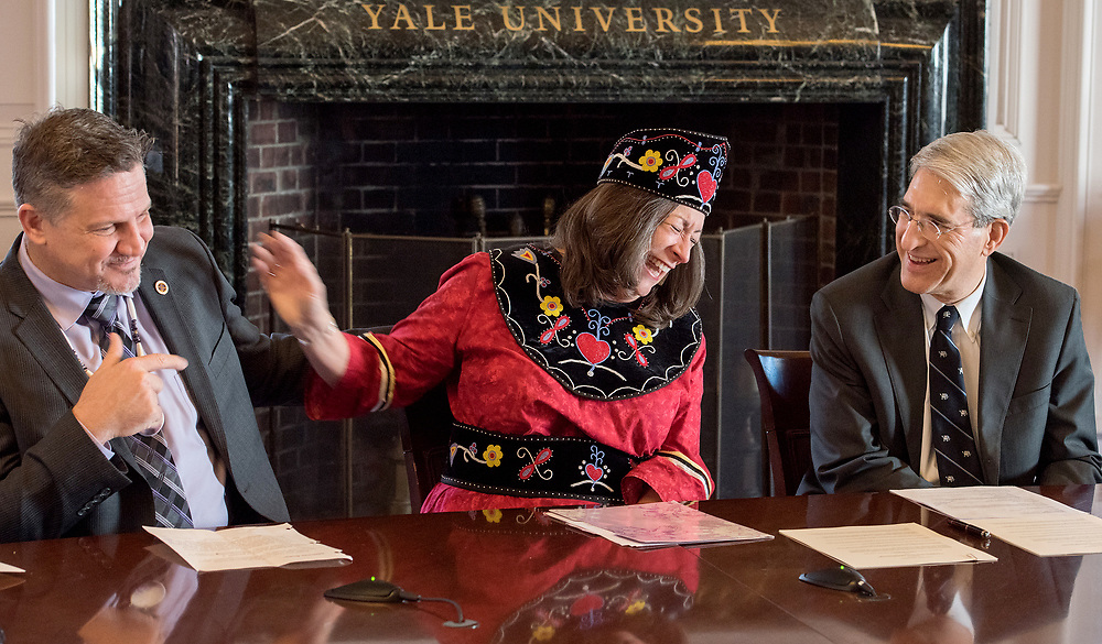 Photo by Mara Lavitt<br /> New Haven, CT<br /> November 17, 2017<br /> Photography: ©Mara Lavitt<br /> <br /> In Woodbridge Hall, Yale and the Mohegan Tribe signed an agreement that formalized cooperation between the Yale Peabody Museum of Natural History and the Mohegan Tribe's Tantaquidgeon Museum. Mohegan Tribal Chairman Kevin Brown; Mohegan Chief Marilynn Malerba  and President Peter Salovey.
