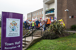 Maidenhead, UK. 23rd February, 2019. Members of the Windsor and Maidenhead branches of the Labour Party and UNISON and GMB trade unions protest outside Maidenhead Town Hall in Prime Minister Theresa May's constituency against planned spending cuts of £6.8m to the 2019/2020 budget by the Royal Borough of Windsor and Maidenhead. Over 1,000 people had signed a petition to the council demanding an alternative to the cuts.