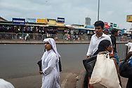 A Catholic nun walks on a street in Colombo, Sri Lanka. Around eight percent of the country's population is Christian, the majority of whom are Roman Catholic.