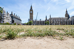 © Licensed to London News Pictures. 07/07/2017. London, UK. Scorched grass and dust are seen on the edge of Parliament Square as parts of the United Kingdom enjoy high temperatures and blue sky. Photo credit: Peter Macdiarmid/LNP