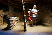 Missy Masanetz (right) and her eight year-old daughter, Mikayla (left) read up on the story behind the kiva at the Spruce Tree House site during a self-guided tour of the site one afternoon. The Masanetz live in Loveland, Co. and said it was their first time at Mesa Verde. The archeological sites found in Mesa Verde National Park, near Cortez, Co., are some of the most notable and best preserved sites in the United States. Mesa Verde offers visitors a spectacular look into the lives of the Ancestral Pueblo people. The culture represented at Mesa Verde reflects more than 700 years of history. From approximately A.D. 600 through A.D. 1300 people lived and flourished in communities throughout the area, eventually building elaborate cliff dwellings in the sheltered alcoves of the canyon walls. Mesa Verde National Park is a U.S. National Park and UNESCO World Heritage Site located in Montezuma County, Colorado, United States. The park occupies 81.4 square miles (211 square kilometers) and features numerous ruins of homes and villages built by the ancient Pueblo people. It is best known for several spectacular cliff dwellings ? structures built within caves and under outcroppings in cliffs ? including Cliff Palace, which is thought to be the largest cliff dwelling in North America..(MARC PISCOTTY/ © 2005)