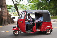 """Tuk Tuk or """"three wheeler"""" is one of the chief modes of transport across many parts of Asia as a vehicle for hire. It is a motorized version of the traditional rickshaw or velotaxi, a small three-wheeled cart and are usually powered by 2 cycle or 4 cycle motorbike engines."""