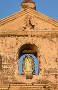 Detail of an old bell tower with a Virgin Mary statue, Guadalupe Church, Granada, Nicaragua