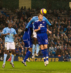 MANCHESTER, ENGLAND - Monday, February 25, 2008: Everton's Philip Jagielka heads clear from Manchester City's Darius Vassell during the Premiership match at the City of Manchester Stadium. (Photo by David Rawcliffe/Propaganda)