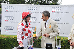 PHILIPPA HOLLAND and ROWAN ATKINSON at the 3rd day of the 2012 Glorious Goodwood racing festival at Goodwood Racecourse, West Sussex on 2nd August 2012.