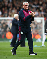 Steve Bruce of Aston Villa applauds his fans after the game in the Sky Bet Championship match at Craven Cottage, London<br /> Picture by Richard Brooks/Focus Images Ltd 07947656233<br /> 17/04/2017
