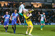 Plymouth Argyle forward Freddie Ladapo (19) battles withWycombe Wanderers goalkeeper Ryan Allsop(1) during the EFL Sky Bet League 1 match between Wycombe Wanderers and Plymouth Argyle at Adams Park, High Wycombe, England on 26 January 2019.