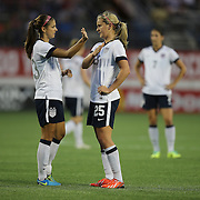 U.S. forward Alex Morgan (13) gives instructions to U.S. forward Lindsey Horan (25) during a women's soccer International friendly match between Brazil and the United States National Team, at the Florida Citrus Bowl  on Sunday, November 10, 2013 in Orlando, Florida. The U.S won the game by a score of 4-1.  (AP Photo/Alex Menendez)