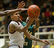 Keith Fraizer (2) of Kimball drives to the basket against Carrollton Newman Smith in the Class 4A area-round playoff game Friday, February 22, 2013 at the Alfred J. Loos Field House in Addison, Texas. (Cooper Neill/The Dallas Morning News)