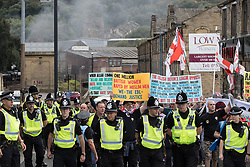 © Licensed to London News Pictures . 02/09/2017 . Keighley , UK . Far-right street protest movement , the English Defence League ( EDL ) , hold a demonstration in the West Yorkshire town of Keighley , opposed by anti-fascists , including Unite Against Fascism ( UAF ) . The EDL say they are demonstrating against the sexual grooming and abuse of English girls by Muslim men and against terrorism across the UK . Photo credit : Joel Goodman/LNP