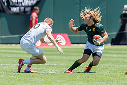 July 22, 2018 - San Francisco, CA, U.S. - SAN FRANCISCO, CA - JULY 22: South Africa's Werner Kok attempts to avoid a tackle during the match between England and South Africa at the Rugby World Cup Sevens on July 22, 2018 at AT&T Park in San Francisco, CA. (Photo by Bob Kupbens/Icon Sportswire) (Credit Image: © Bob Kupbens/Icon SMI via ZUMA Press)