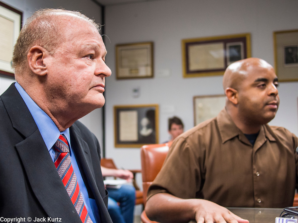 21 OCTOBER 2013 - PHOENIX, AZ: Arizona Attorney General TOM HORNE (center right) at a meeting with DREAM Act protesters. The DREAMers are protesting the decision by Attorney General Horne to sue the Maricopa County Community College District to force the district to charge in-state tuition to the young people who qualify for the federal government deferred-action program.     PHOTO BY JACK KURTZ