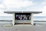 The commissioned portraits by photographer Niall McDiarmid are displayed on a seafront promenade shelter at Llandudno, on 4th October 2021, in Llandudno, Gwynedd, Wales.