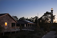 NC00881-00....NORTH CAROLINA - Sunset on Cape Lookout Lighthouse and Visitors Center on the South Core Banks in Cape Lookout National Seashore.
