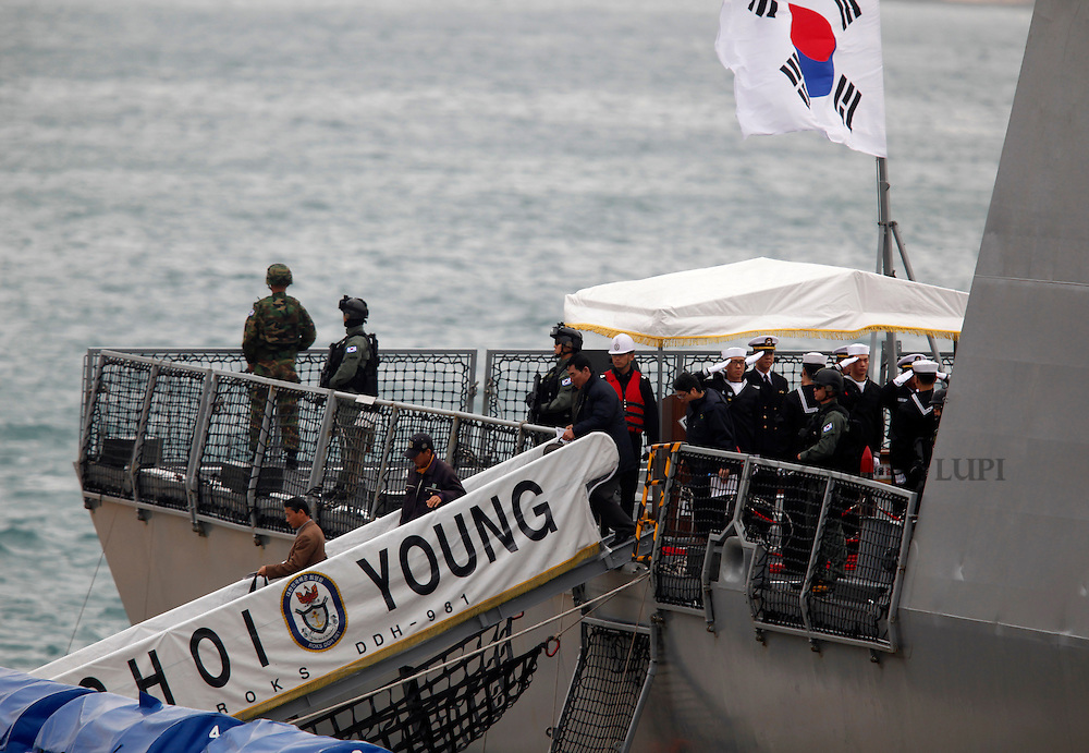 Passengers disembark from the South Korean Navy destroyer Choi Young after it arrived in Valletta's Grand Harbour March 4, 2011.  The ship evacuated 32 South Korean nationals from Tripoli, according to an embassy official.  Over 14,000 people have been evacuated from Libya to Malta since the crisis broke out, according to local officials..REUTERS/Darrin Zammit Lupi (MALTA)