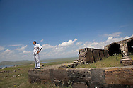 A famous 11th Century caravansaray and an old church (on the photo) were relocated to a hill overlooking Jrapi when the Akhuryan reservoir on the border between Armenia and Turkey was built ...Stones were numbered so the church could be later reconstructed on the hill above reservoir .
