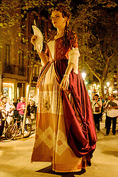 A procession marks the beginning of the Catalan Weekend celebrations in the Square de les Moreres in Barcelona. This square contains the memorial to those who perished in the 1713-1714 siege of Barcelona.<br /> <br /> (c) Andrew Wilson   Edinburgh Elite media