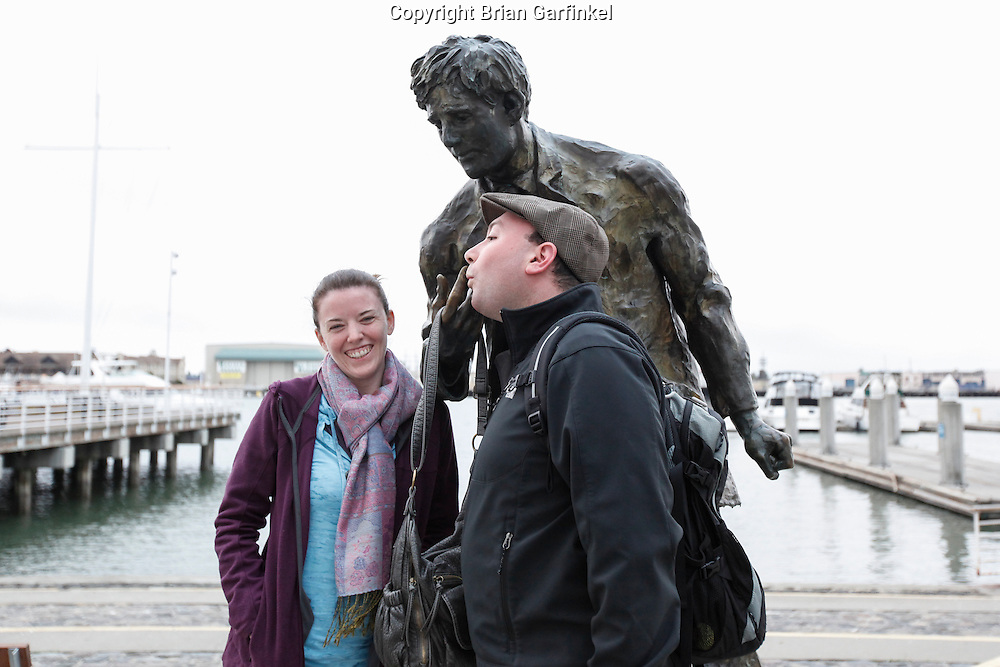 Allison and I pose with a statue of Jack London in Jack London Square on Monday July 16th 2012 in Oakland, California. (Photo By Brian Garfinkel)