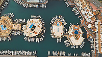 Aerial view of boats parked along circular houses in a beautiful harbour  Puerto Marina, Benalmadena, Spain