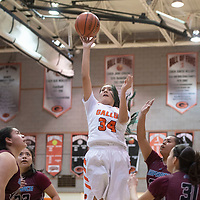 Gallup Bengal Jordan Joe (34) takes a shot inside the paint in their district 1-4A championship game against the Shiprock Chieftains Saturday night at Gallup High School in Gallup. The Bengals beat the Chieftains 72-57.