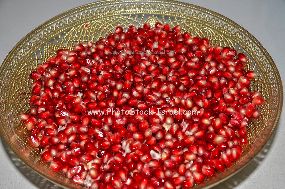 A bowl of pomegranates seeds