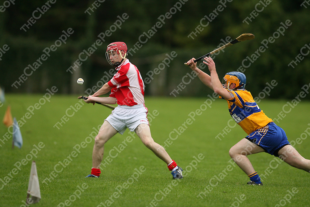 Sixmilebridge's 4 tries to block the shot by Eire Og's 13 during their game in Clareabbey on Sunday eveningl<br /> Photograph by Yvonne Vaughan