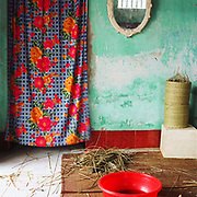 Interior of a home in Kim Chinh, sedge basket weaving village, Ninh Binh province, Vietnam. With Vietnam's growing population making less land available for farmers to work, families unable to sustain themselves are turning to the creation of various products in rural areas.  These 'craft' villages specialise in a single product or activity, anything from palm leaf hats to incense sticks, or from noodle making to snake-catching. Some of these 'craft' villages date back hundreds of years, whilst others are a more recent response to enable rural farmers to earn much needed extra income.