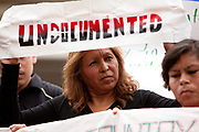 BIRMINGHAM, AL –SEPTEMBER 16, 2012: Dozens of undocumented Hispanic demonstrators gather outside of the  Sheraton Hotel in Birmingham, Alabama to protest during a briefing on the civil rights effects of state immigration law held by the U.S. Commission on Civil Rights in Birmingham, Alabama on August 17, 2012.