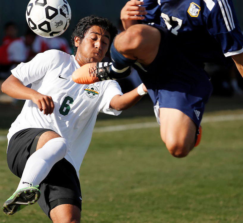 11/4/16 3:26:46 PM  -- Fullerton College's Armando Torres (27) fights Golden West College's Mauricio Magallon (6) for the ball.  Golden West won the match 2-0. --Fullerton College, Fullerton, Ca<br /> <br /> Photo by Joe Bergman / Sports Shooter Academy