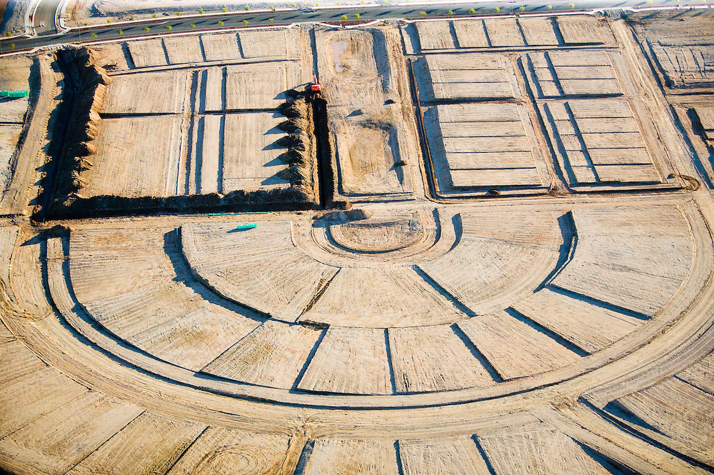 Grading lots and laying down underground infrastructure make up the early part of construction in the 11,000-home community of Verrado.  The community is designed with many small neighborhoods, each with its own individual character.
