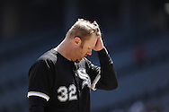 CHICAGO - APRIL 24:  Adam Dunn #32 of the Chicago White Sox reacts after striking out against the Cleveland Indians on April 24, 2013 at U.S. Cellular Field in Chicago, Illinois.  The White Sox defeated the Indians 3-2.  (Photo by Ron Vesely)   Subject: Adam Dunn