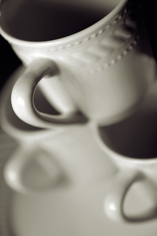 coffee mugs piled blalck and white verticle