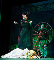 Carabosse (Ursula Boutwell) stands over Aurora (Rebecca Tucker) after she pricks her finger on the spindle with Herman the Henchman (John Piquado) looking on during dress rehearsal for Sleeping Beauty at the Winnipesaukee Playhouse Tuesday afternoon.  (Karen Bobotas/for the Laconia Daily Sun)