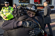The morning after the terrorist attack at Fishmongers Hall on London Bridge, in which Usman Khan a convicted, freed terrorist killed 2 during a knife a attack, then subsequently tackled by passers-by and shot by armed police - Met Police Commissioner Cressida Dick hugs a local lady before touring Borough Market, on 30th November 2019, in London, England.