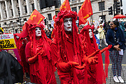 Mime artists dressed in red with white face paint during a demonstration against U.S. President Donald Trumps state visit to the U.K on the 4th June 2019 in London in the United Kingdom. Day two of President Trumps three-day state visit, which includes lunch with the Queen, a State Banquet at Buckingham Palace as well as business meetings with the Prime Minister and the Duke of York, before travelling to Portsmouth to mark the 75th anniversary of the D-Day landings.