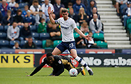 Fred Onyedinma of Millwall and Paul Huntington of Preston North End contest a loose ball during the EFL Sky Bet Championship match between Preston North End and Millwall at Deepdale, Preston, England on 23 September 2017. Photo by Paul Thompson.