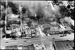 July 17, 1977 - Michigan, U.S. - Twelfth Street is pictured under a cloud of smoke during the rioting in 1967. Errant flames of the 1967 riot swept into residential sections destroying solid homes of longtime residents. (Credit Image: © Detroit Free Press via ZUMA Wire)