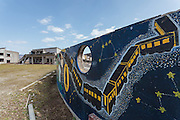 A mural depicting a scene from famous Tohoku author, Kenji Miyazawa's book Night On The Galactic Railroad among the ruins of Okawa Elementary school in Ishinomaki, Miyagi, Japan. Thursday March 10th 2016. The Great East Japan Earthquake struck at 2:46pm on March 11th 2011 levelling much of the Tohoku coast and causing the deaths of around 18,000 people. including 84 students and staff at Okawa Elementary School.