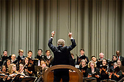"""Penn Choral Director William Parberry conducts the University Choir through an intense section of """"The Circus Band,"""" a piece by Charles Ives, performed at a concert held at University of Pennsylvania's Irvine Auditorium in Philadelphia, Pennsylvania on April 7, 2018."""