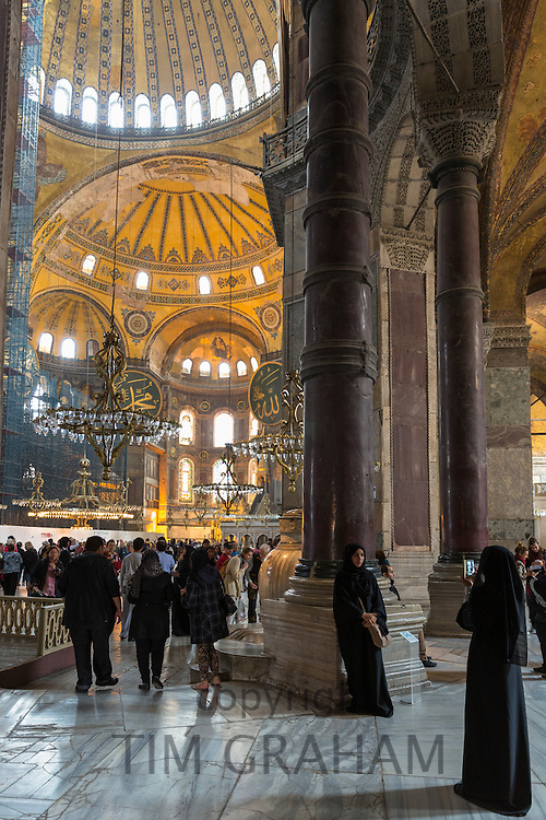 Muslim women at Hagia Sophia Ayasofya Muzesi mosque museum in niquab using smartphone to take photograph Istanbul, Turkey