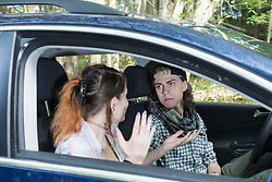 Young couple arguing in a car, Bavaria, Germany