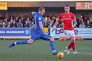 AFC Wimbledon striker James Hanson (18) with a shot on goal during the EFL Sky Bet League 1 match between AFC Wimbledon and Charlton Athletic at the Cherry Red Records Stadium, Kingston, England on 23 February 2019.
