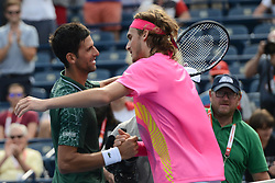 August 9, 2018 - Toronto, Ontario, Canada - NOVAK DJOKOVIC of Serbia and STEFANOS TSITSIPAS of Greece meet at the net after their third round match vs. N. Djokovic in the Rogers Cup tennis tournament in Toronto Canada. (Credit Image: © Christopher Levy via ZUMA Wire)