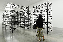 """© Licensed to London News Pictures. 11/09/2019. LONDON, UK. A visitor views """"Quarters"""", 2017. Preview of """"Remains to be Seen"""", a new exhibition by Mona Hatoum at White Cube gallery in Bermondsey.  This is the first presentation of her work since Tate Modern in 2016.  The show runs 12 September to 3 November 2019.  Photo credit: Stephen Chung/LNP"""