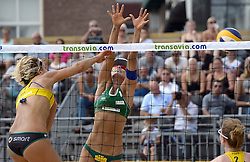 17-07-2014 NED: FIVB Grand Slam Beach Volleybal, Apeldoorn<br /> Poule fase groep G vrouwen - Agatha Bednarczuk (1) BRA, Laura Ludwig (1) GER